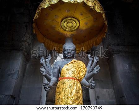 Ancient Vishnu statue at Angkor Wat temple, Siem Reap, Cambodia. - stock photo