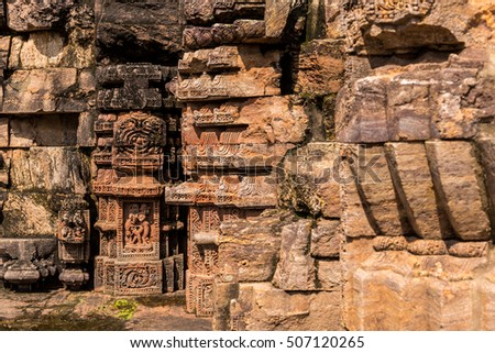 Ancient wall carvings and rock sculptures in the historic temple of Konark, India.
