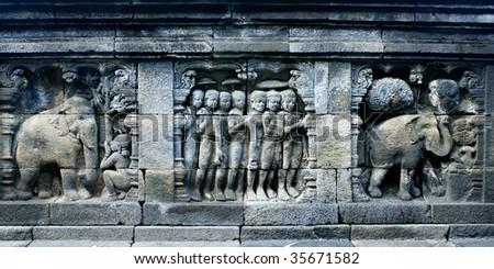 Ancient wall stone carving, Borobodur temple, Yogyakarta, Indonesia - stock photo