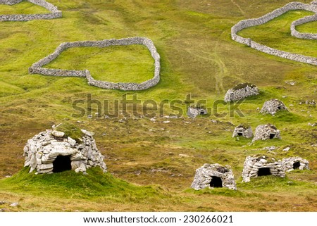 Ancient wall structures and shelters on the remote archipelago of St Kilda, Outer Hebrides, Scotland - stock photo