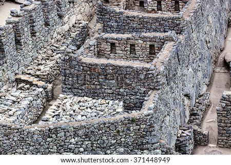 ancient walls and houses to Machu Picchu - stock photo