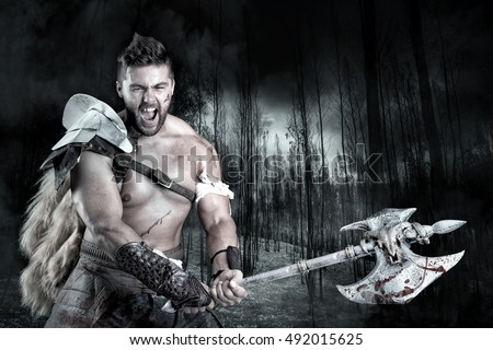 Ancient warrior or Gladiator ready to fight in a dark forest