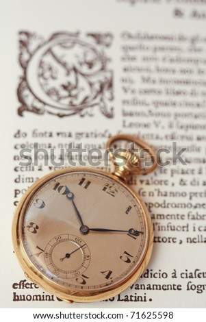 Ancient watch on a vintage book