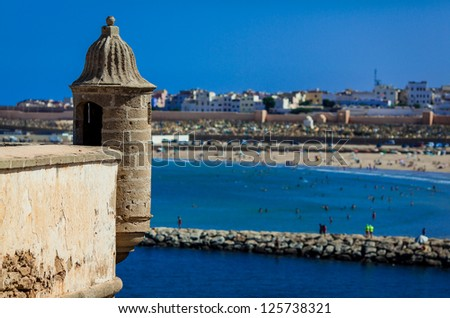 Ancient watchtower with the beach and sky in the background - stock photo