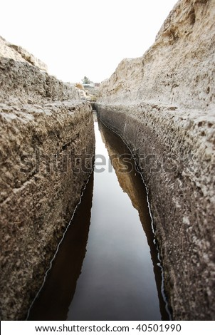 ancient water canal - stock photo