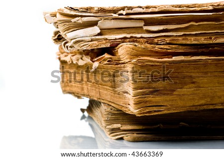 Ancient weathered paper book isolated on white - stock photo