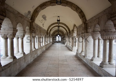 ancient white corridor with arch in budapest - stock photo