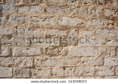 Ancient white stone wall for Background or Texture