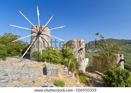 Ancient windmills of Lasithi Plateau on Crete, Greece - stock photo