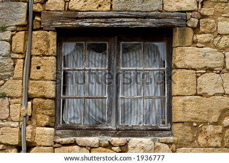 Ancient window in Beynac, Dordogne, France