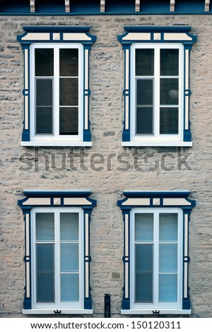 Ancient window of old building in Quebec City - stock photo