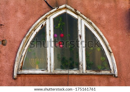 ancient window with khanukiyah.Tel Aviv.Israel - stock photo