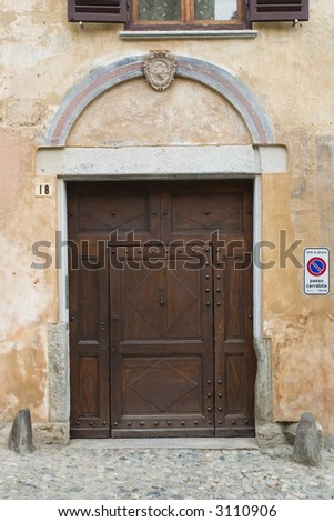 ancient wood door in Saluzzo, a beautiful town in Italy
