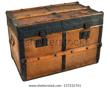 Ancient wooden chest with black metal protection isolated on a white background - stock photo