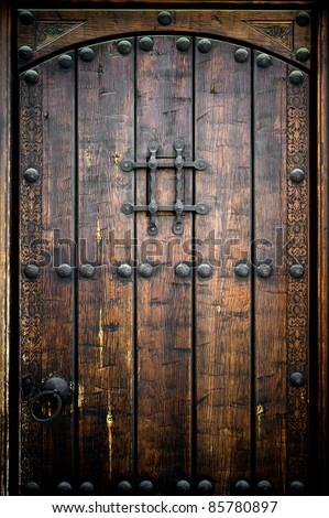 Ancient wooden door - stock photo