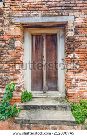 Ancient wooden door thai style - stock photo