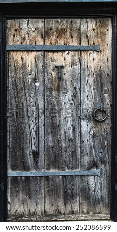 ancient Wooden door with brass iron ring - stock photo