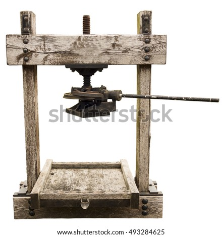 Ancient wooden press for fruits isolated on white background.