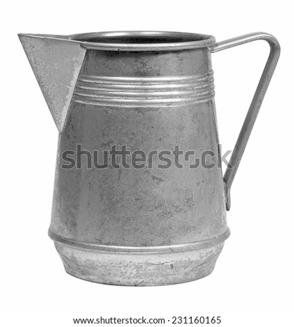 Ancient worn out tin milk jug isolated on white  - stock photo