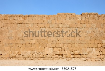 Ancient yellow stone wall texture - stock photo