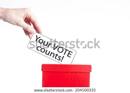 and puting ballot into red box - stock photo