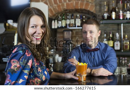 and the bartender girl near the bar - stock photo