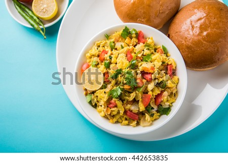 Anda bhurji or Spicy scrambled eggs with bread slices or pav or paav and green salad