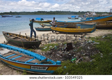 ANDAMAN ISLANDS, INDIA - AUGUST 31: Boatmen with traditional boats on August 31, 2011 at Andaman Islands, India. Andaman island includes some two hundred islands in the Bay of Bengal. - stock photo