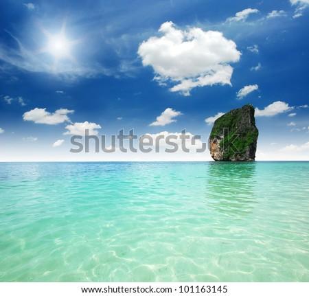 Andaman sea against blue sky at railay bay Krabi bay Thailand rainbow - stock photo