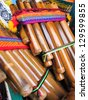 Andean flutes in a traditional product market. Chile, - stock photo