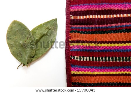 Andean tapestry with Coca Leaves - stock photo