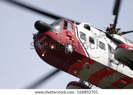 ANDIJIK, THE NETHERLANDS - APRIL 24 ,2013 :Front of a Dutch rescue helicopter flies through the air on april 24,2013 in Andijk, the netherlands.  - stock photo