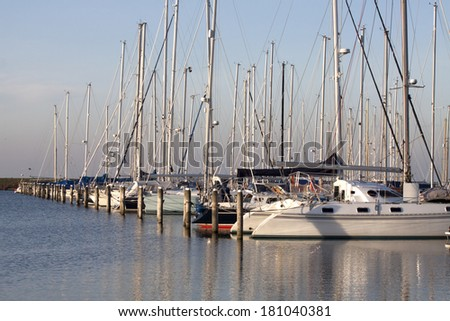 ANDIJK , THE NETHERLANDS - 12 JANUARY : Sailboats in the marina on january 12,2014 in Andijk, The Netherlands. - stock photo
