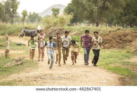 ANDOURE, RAJASTHAN, INDIA - July 24, 2016: unidentified rural young boys and girls running in rural village Andoure, July 24, 2016 Andoure, Rajasthan, India