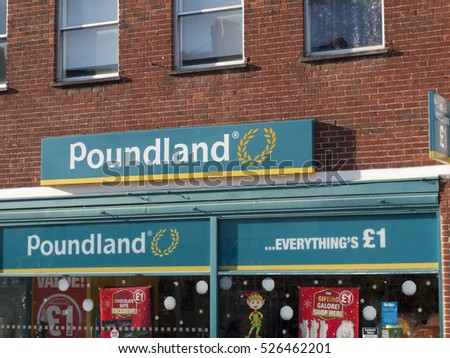 Andover, High Street, Hampshire, England - 29 November, 2016: Poundland shop sign over premises, company founded in 1990 by Dave Todd and Stephen Smith