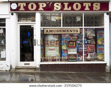 Andover, High Street, Hampshire, England - September 21, 2015: Top Slots Amusement Arcade, late rain soaked afternoon