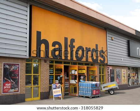 Andover, Retail Park, Hampshire, England - September 18, 2015: Halfords Group plc store, UK retailer of car parts, car enhancement, camping, touring and bicycles, founded in 1892 - stock photo