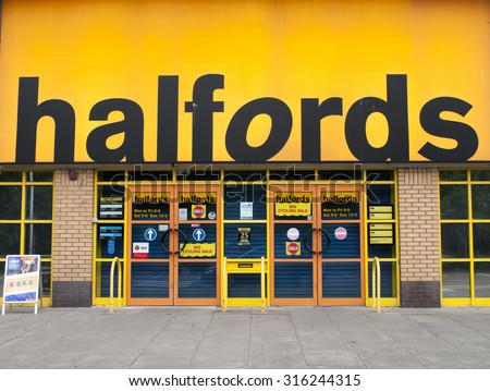 Andover, Retail Park, Hampshire, England - September 7, 2015: Halfords Group plc store, UK retailer of car parts, car enhancement, camping, touring and bicycles, founded in 1892 - stock photo