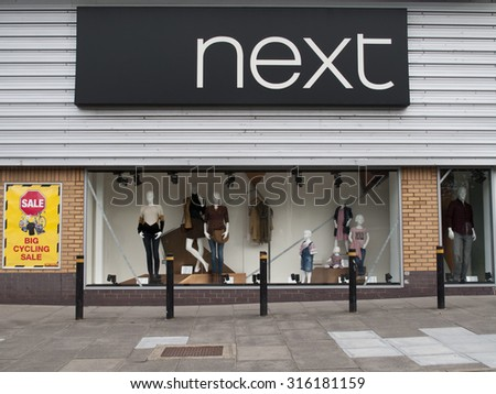 Andover, Retail Park, Hampshire, England - September 13, 2015: Next women and men fashion clothing store, company founded by Joseph Hepworth in Leeds in 1864 - stock photo