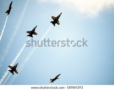 ANDREWS AFB, WASHINGTON DC- MAY 16: US Navy Demonstration Squadron Blue angels, flying on Boeing F/A-18 showing precision of flying in signature starburst maneuver on May 16, 2010 in Washington DC. - stock photo