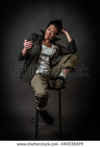 Androgen. Androgynous character on a gray background. Man or woman. Military style. Very sharp.