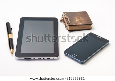 Android tablet and phone and old antique paper notebook with black pen. - stock photo