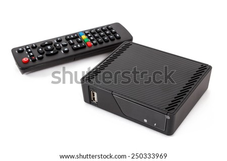 Android TV set top box receiver with remote controler isolated on white - stock photo