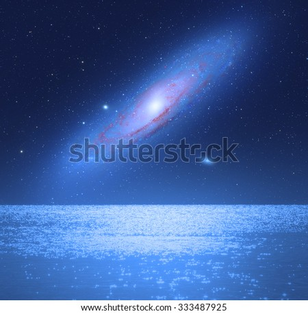 Andromeda rising over horizon. No elements of NASA or other third party. - stock photo