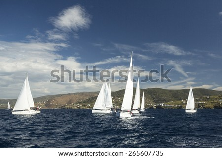 ANDROS, GREECE - CIRCA OCT, 2014: Sailboats participate in sailing regatta 12th Ellada Autumn 2014 among Greek island group in the Aegean Sea, in Cyclades and Argo-Saronic Gulf. - stock photo