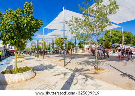 ANDUJAR,SPAIN - September, 6: tents and umbrellas to avoid the sun during the famous Andalusian Horse Fairon September, 6, 2014 in Andujar, Spain - stock photo