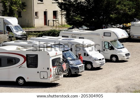 ANDUZE, FRANCE - JULY 14 : The motorhome parked in Anduze the time for homeowners to make the trip by the tourist steam train station, July 14, 2014.