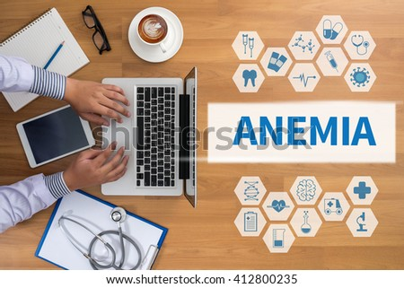 ANEMIA Professional doctor use computer and medical equipment all around, desktop top view, coffee - stock photo