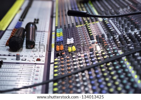 Ange view on sound mixer with regulation buttons - stock photo