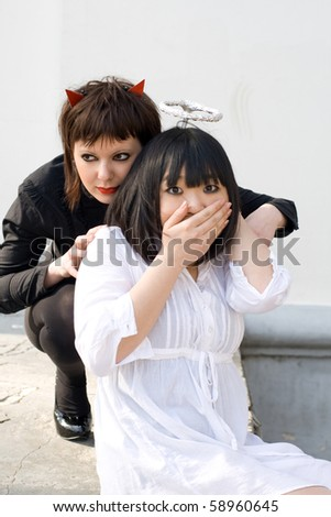Angel and devil - stock photo